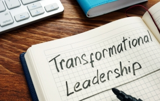 Transformational leadership handwritten in a note pad.